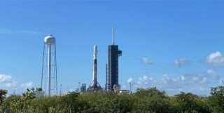 A SpaceX Falcon 9 rocket carrying 57 Starlink internet satellites and two BlackSky Global Earth-imaging satellites stands atop its Pad 39A launch site at NASA's Kennedy Space Center, Florida on July 8, 2020.