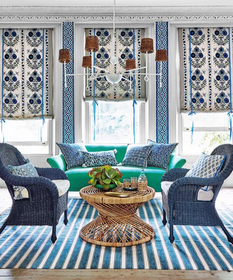Light living room with rattan table and chairs and patterned blinds