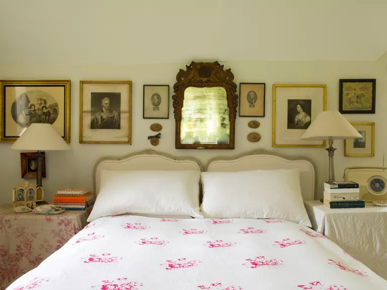 Cottage bedroom ideas - bedhead surrounded by antique accessories in cottage bedroom style