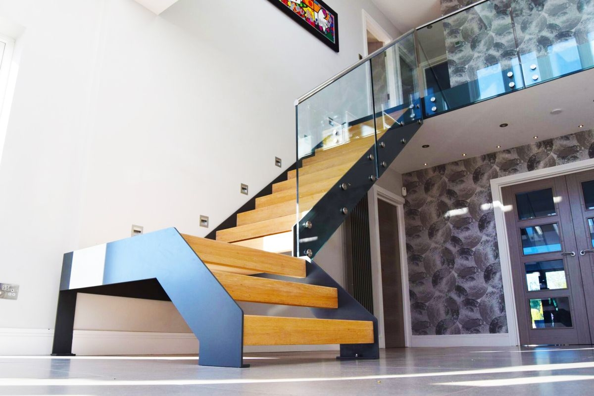Staircase Renovation How To Design A Staircase Real Homes   Glass Balustrade Staircase Cost   Steel Plate   Floating Staircase   Zig Zag   Curved Glass   Stair Railing