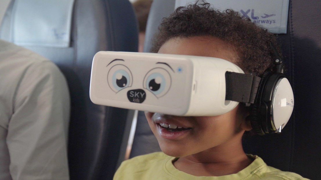 Child wearing VR headset on a plane
