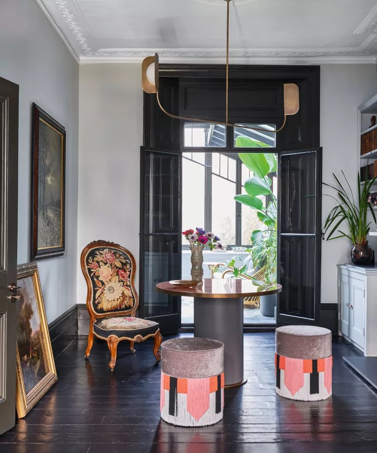 Black living room with white walls and black door and window frames