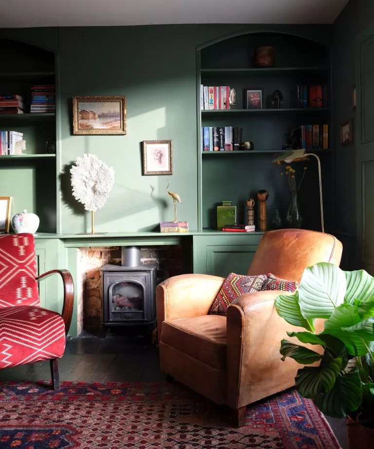 Green living room with leather armchair and patterned rug