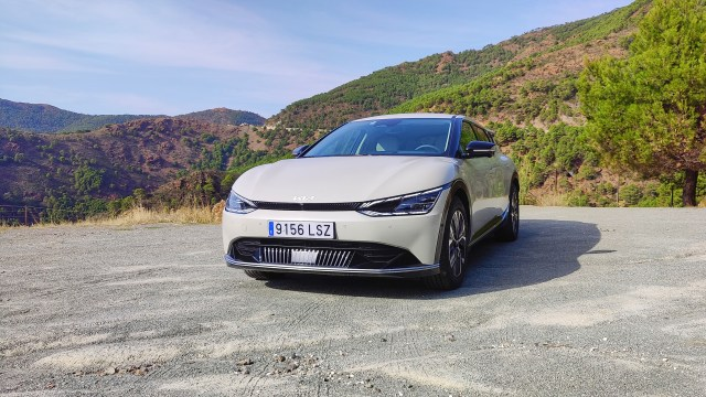 Front on, at an angle, view of Kia EV6 parked in a layby in the mountains
