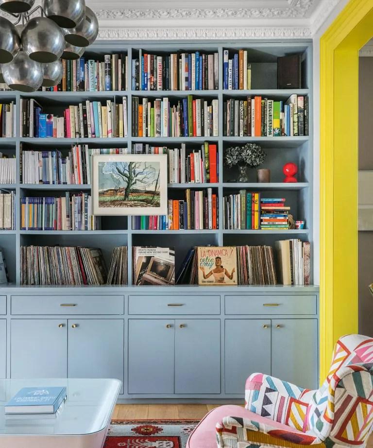 Living room with blue bespoke shelving