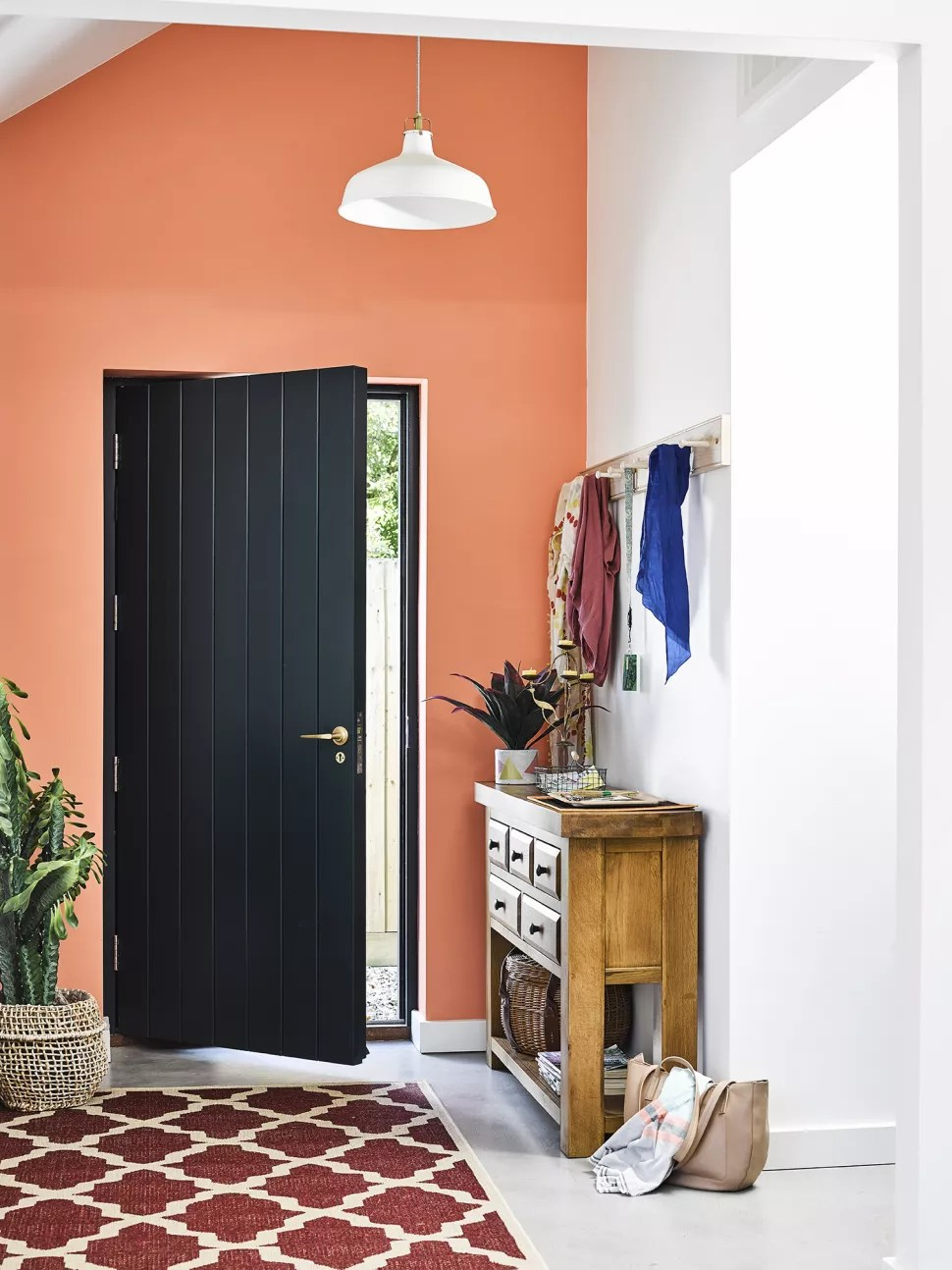small hallway ideas with a bright painted wall