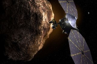 An artist's depiction of the Lucy spacecraft studying an asteroid.