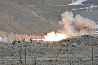 The second stage motor for Northrop Grumman's new OmegA rocket, the Castor 300, roars to life during a static fire at the company's propulsion facility in Promontory, Utah on Thursday, Feb. 27, 2020.