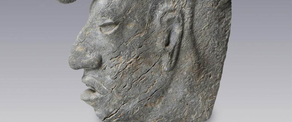 Hacha escultura votiva con rostro humano  El Mxico