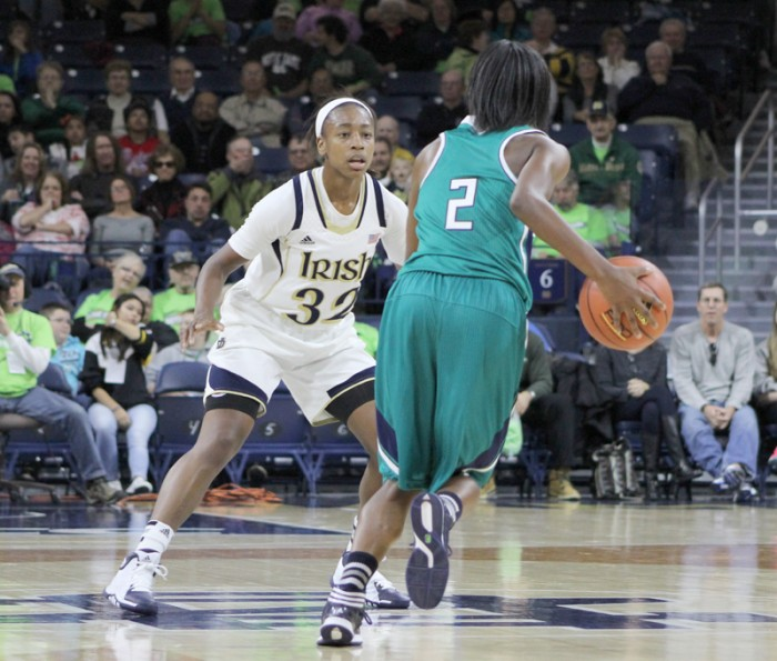 Irish sophomore guard Jewell Loyd defends UNC Wilmington freshman guard Brie Mobley at the top of the key during the Irish 99-50 win over the Seahawks on Nov. 9. Loyd led the Irish with 19 points on 8-11 shooting, while Mobley only scored 12 points on 4-12 shooting.