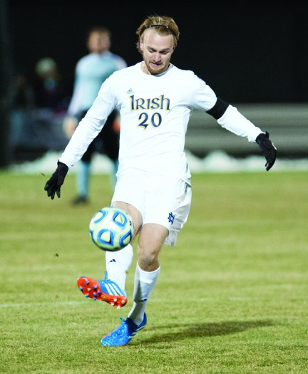 Former Irish center back Grant Van De Casteele passes in Notre Dame's 4-0 win Nov. 24, 2013, against Wisconsin. Casteele was drafted by the Colorado Rapids in the first round of the MLS draft Thursday.