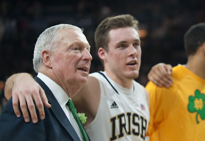 Digger Phelps, left, and Pat Connaughton sing the Alma Mater after Notre Dame's 70-63 victory over Virginia Tech on Sunday. Phelps became the sixth person and first Irish coach to enter the Ring of Honor.