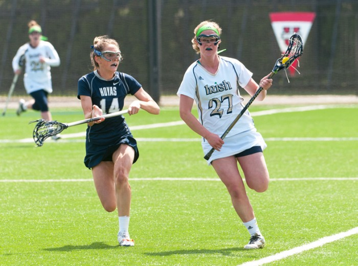 Irish senior defender Molly Shawhan sprints past a Georgetown defender in Notre Dame's 13-12 victory over the Hoyas last season on April 14. Shawhan was recently named a co-captain for the upcoming season.