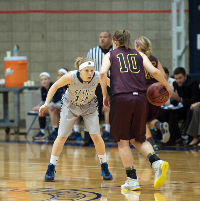 Saint Mary's sophomore guard Maddie Kohler pressures the ball  during the Belles' 95-68 loss to Calvin on Jan. 15.