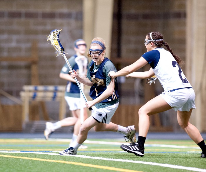 Sophomore attacker Kiera McMullan breaks away from a Michigan defender in Notre Dame's exhibition game Feb. 8.