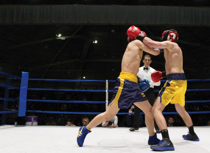 Freshman Ben Hoffner (left) lands a punch on junior Alex Bogucki-Baran during the semifinal round of Bengal Bouts.