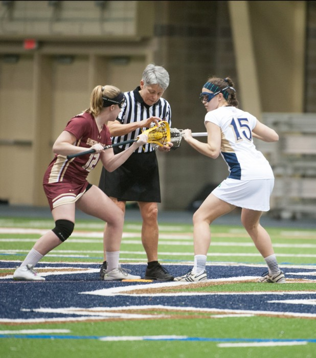 Freshman attack Cortney Fortunato (right) sets up for a draw in Notre Dame's 15-10 loss to Boston College on Feb. 15.