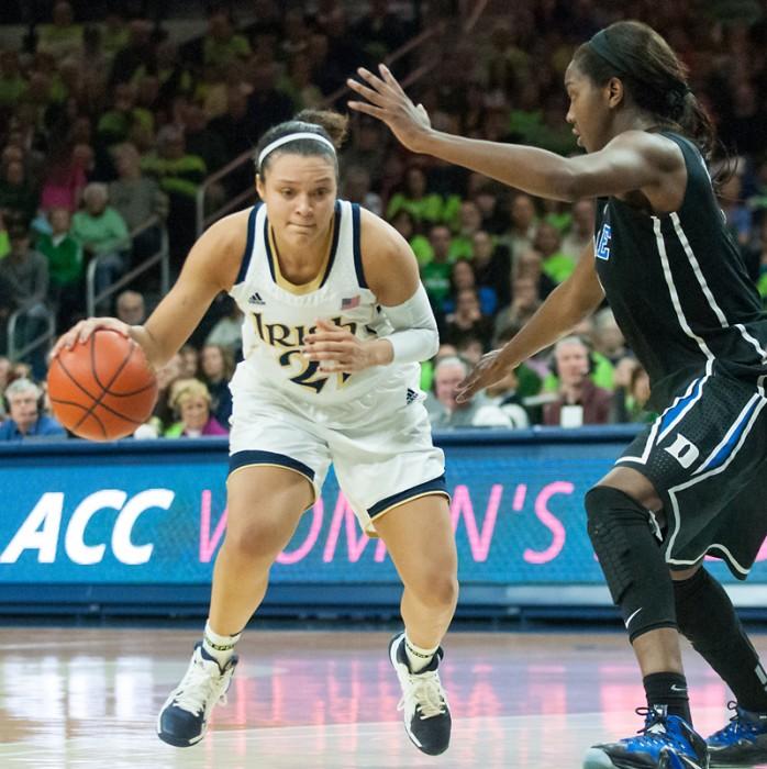 Irish senior guard Kayla McBride drives to the hoop against Duke on  Sunday. McBride had a career-high 31 points in the 81-70 Irish win.