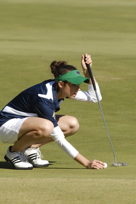 Junior Ashley Armstrong lines up a putt.