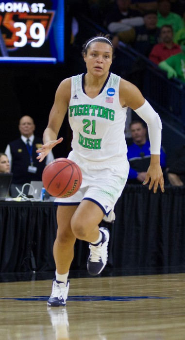 Irish senior guard Kayla McBride takes the ball upcourt during Saturday's Sweet 16 victory over Oklahoma State, 89-72. McBride posted 18 points, five rebounds and four assists in the victory