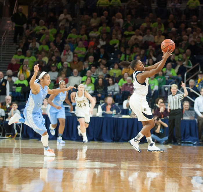 Junior guard Whitney Holloway attempts to gain control of the ball during Notre Dame's 100-75 home win over UNC on Thursday.