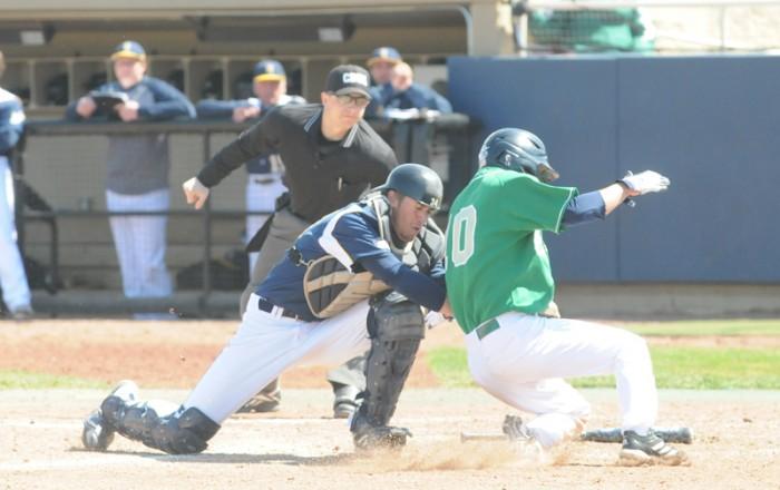 Junior outfielder Conor Biggio barrels into the catcher during Notre Dame's 5-1 victory over Quinnipiac on April 21, 2013