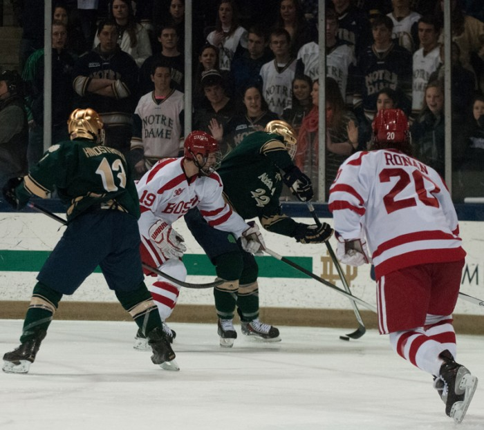 Irish sophomore wing Mario Lucia corrals the puck along the boards during Notre Dame's 2-0 victory over Boston University on Feb. 22.