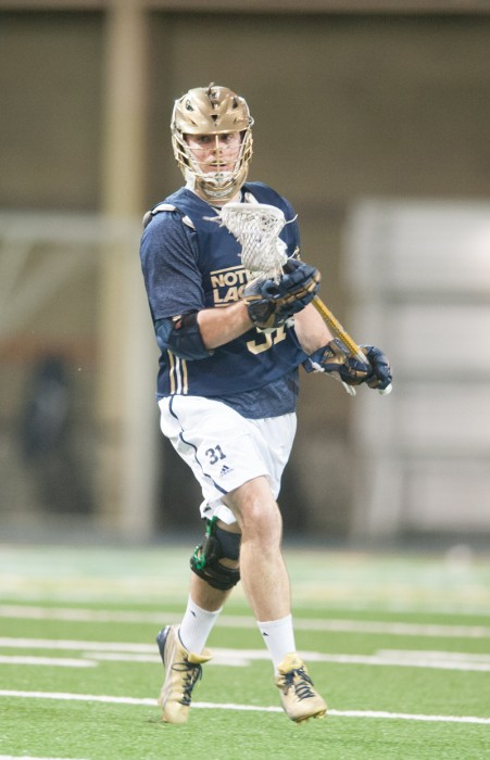 Irish midfielder Liam O'Connor moves upfield in a scrimmage against Detroit on February 2. The senior has won 70 percent of his faceoffs this season.