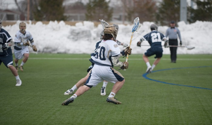 Sophomore attackman Matt Kavanagh tries to slip past a Penn State defender in Notre Dame's 8-7 loss Feb. 22 at Arlotta Stadium.