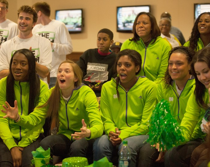 Members of the Notre Dame women's basketball team react to the announcement of their No. 1 seed in the NCAA tournament Monday.