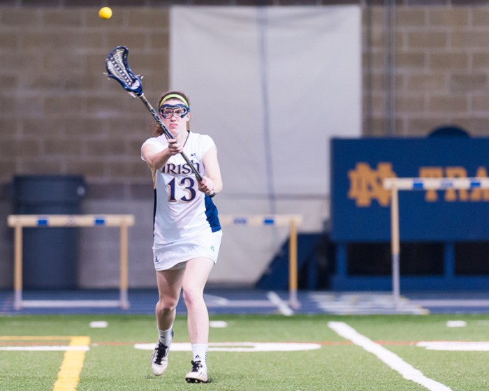 Junior midfield Caitlin Gargan attempts to pass the ball during Notre Dame's 25-1 win over Cincinnati in Loftus Sports Center on Feb. 12.