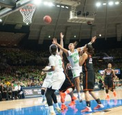 Irish senior guard Kayla McBride throws the ball towards the net.