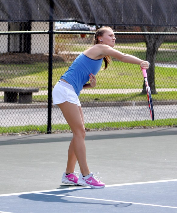 Belles junior Kayle Sexton hits a serve during Saint Mary's match against Hope on April 17.