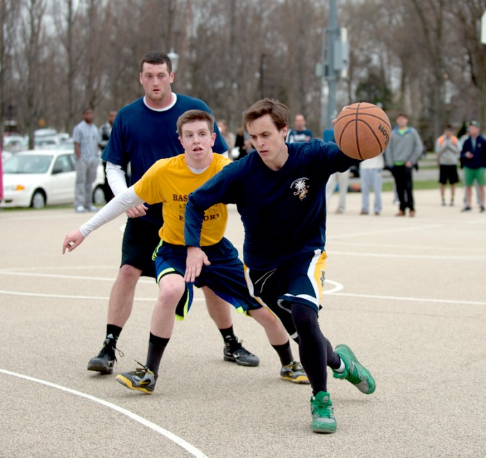 Members of CJ's Party of Five and Touchdown 3s battle during the Elite Eight of Bookstore Basketball. Touchdown 3s won the game, 21-12, and advanced to the Final Four.