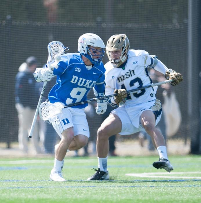 Irish sophomore defenseman Matthew Landis blocks a Duke attackman from getting through to the Irish goal. The Irish fell 15-7 to Duke on April 5.