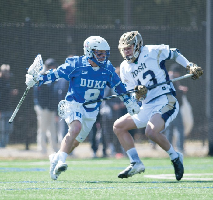 Irish senior midfield Tyler Brenneman defends Saturday during Notre Dame's 15-7 loss to Duke. The defeat dropped the Irish to 2-2 in ACC play.