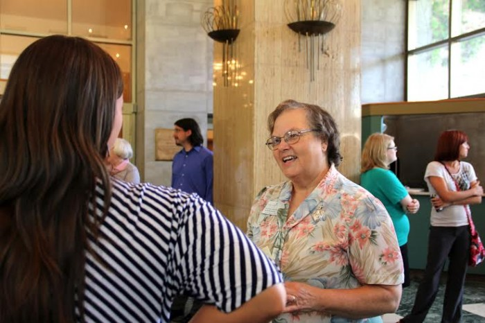 Sister Veronique Wiedower speaks with faculty and staff as her farewell part in the lobby of O'Laughin Auditorium on Wednesday. Wiedower has been at the College since 2011 and is an alum.