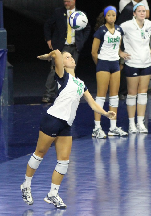 Senior libero Kathleen Severyn serves the ball during Notre Dame's 3-0 exhibition loss to Polish club team Dabrowa on Sept. 8.