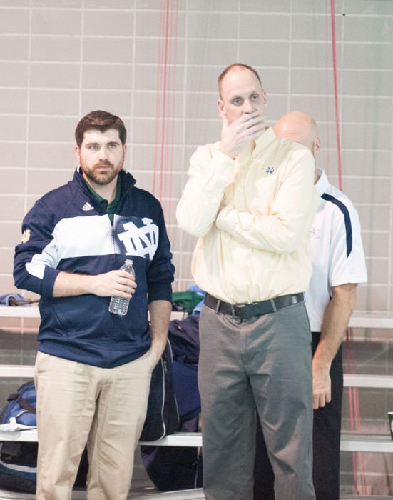 Former Irish coach Brian Barnes, right, watches his team compete against Iowa at the Shamrock Invitational on Jan. 31.