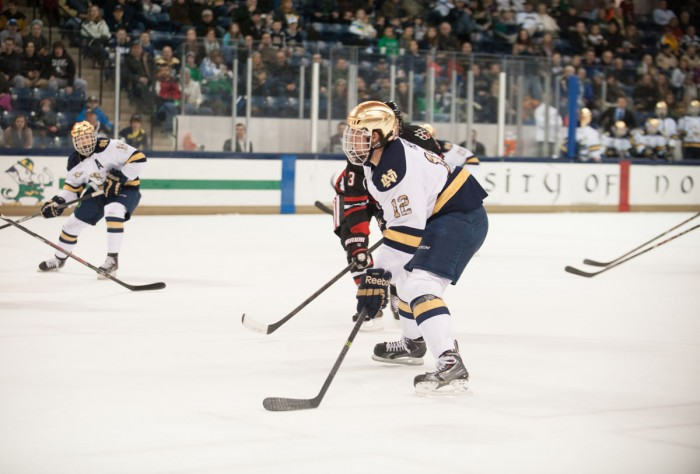 Irish junior left wing Sam Herr pursues the puck in Notre Dame's 4-0 loss to Northeastern Jan. 24 at Compton Family Ice  Arena.