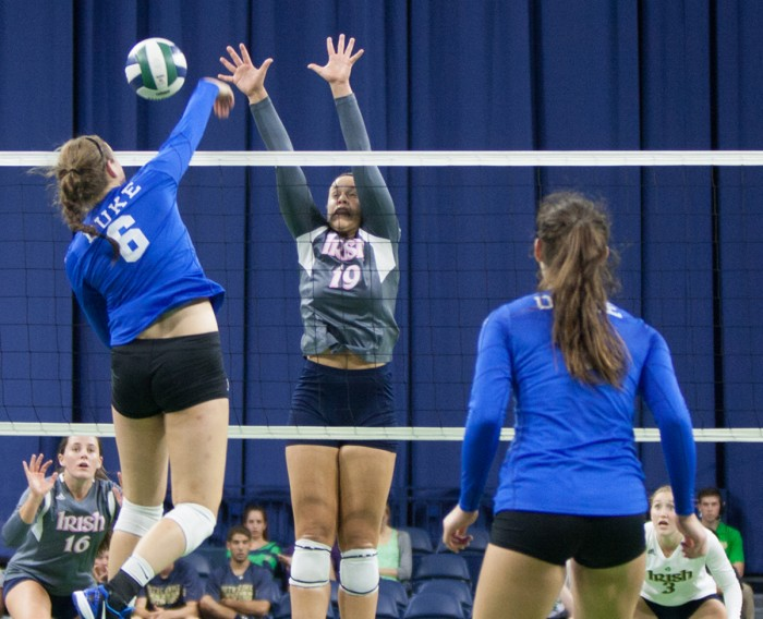 Notre Dame senior middle blocker Jeni Houser tries to get a piece of a kill attempt during a match against Duke on .  Houser leads the Irish in kills so far this season.