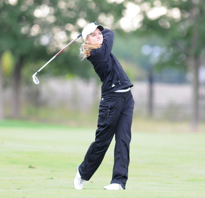 Belles sophomore Ali Mahoney hits a shot at the O'Brien National Invitational at Warren Golf Course on Sep. 15.