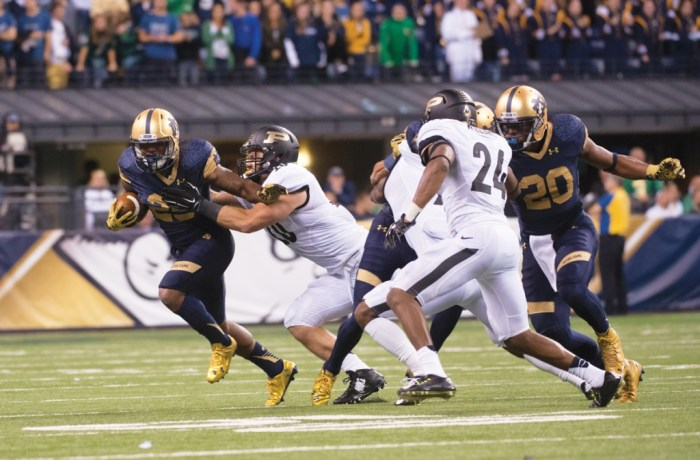 Irish sophomore running back Tarean Folston tries to break away from the Purdue defense.