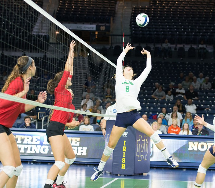 Irish freshman Maddie Dilfer sets the ball in a 3-1 win over Northeastern at home Saturday. The victory came after six consecutive losses to start the season.