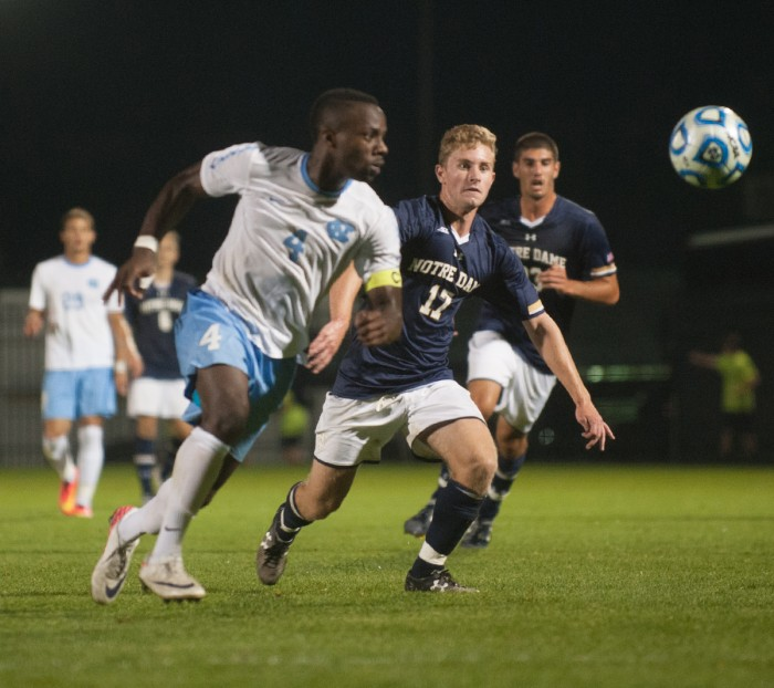 Irish freshman forward Jon Gallagher pursues a loose ball during Notre Dame's 2-0 win over North Carolina on Friday.