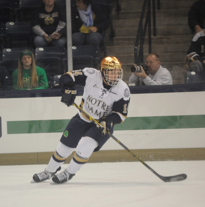 Irish junior center Thomas DiPauli turns toward the puck in Notre Dame's loss Sunday. DiPauli tallied  a first-period goal in the game.
