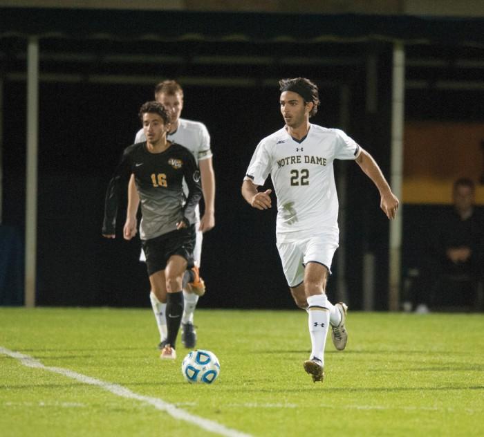 Irish senior defender Luke Mishu sprints to the ball during Notre Dame's 1-0 win against VCU on Tuesday at Alumni Stadium.