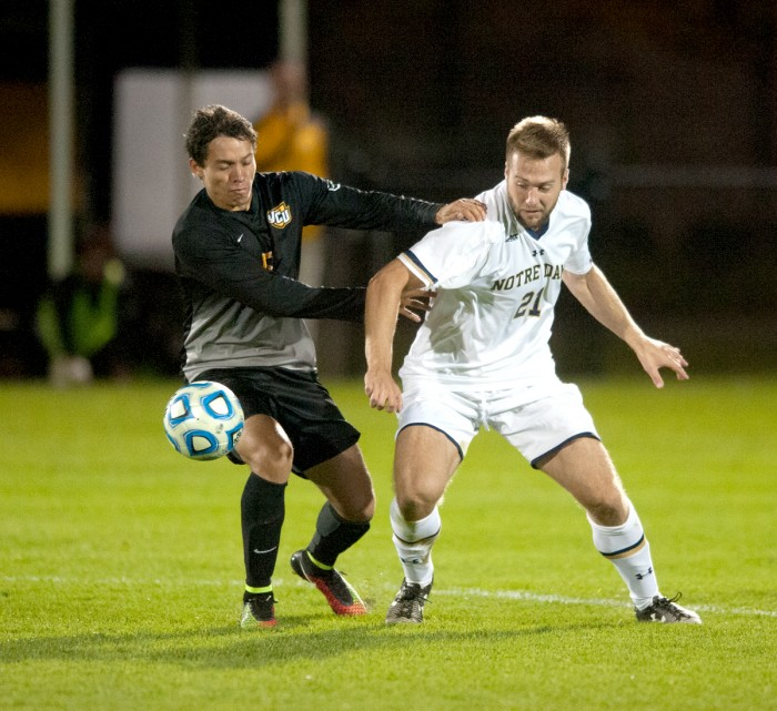 Irish senior midfielder Vince Cicciarelli fights for possession during Notre Dame's 1-0 double-overtime victory over VCU on Sept. 30.
