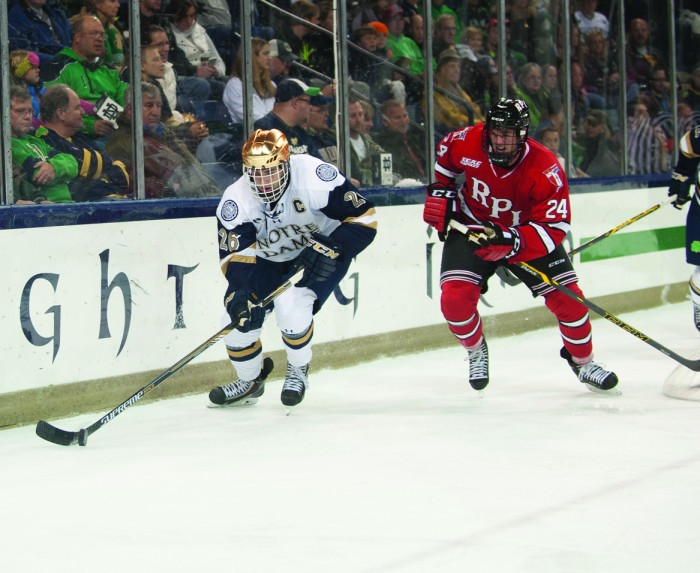 Irish junior center Steven Fogarty powers past a Rensselaer  defender during Notre Dame's 3-2 loss to the Engineers on Oct 10.