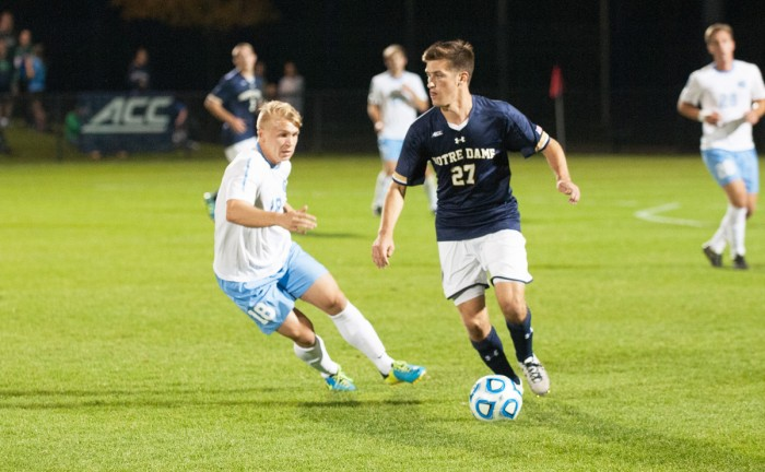 Irish junior midfielder Patrick Hodan dribbles down the field in Notre Dame's 2-0 win against North Carolina on Sept. 26.